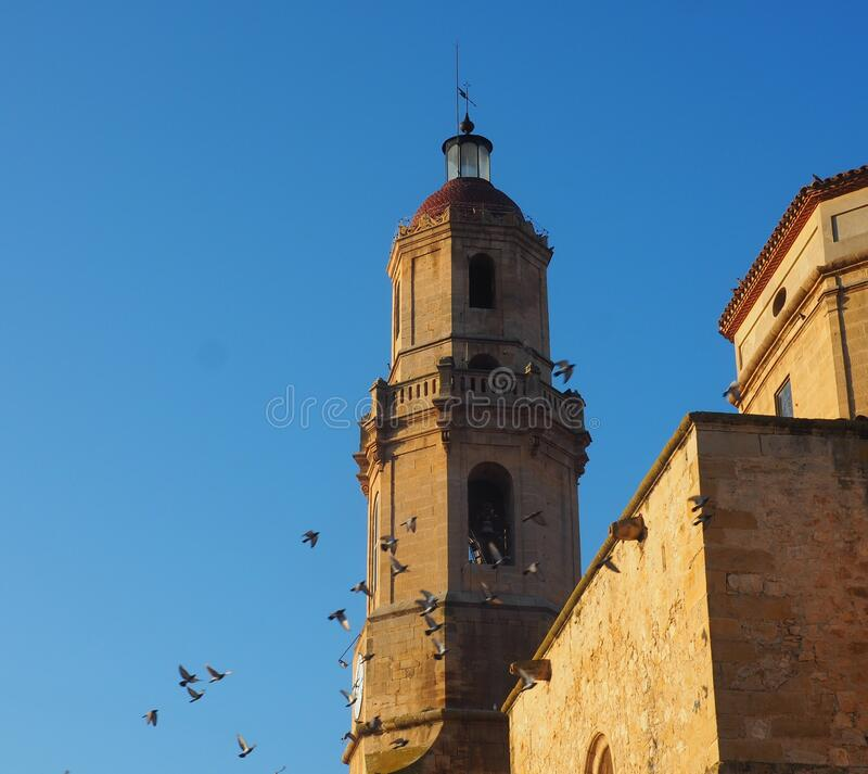 Bell tower of Les Borges Blanques, Lleida, Spain, Europe. Bell tower of Les Borges Blanques, in stone, with five heights and a black cross on the brown dome royalty free stock photos