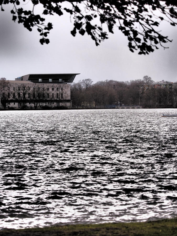 OLYMPUS DIGITAL CAMERA. Dramatic view across the Dutzendteich lake to the Documentation center in the former Nazi Party congress building, Nuremberg, Germany stock photos