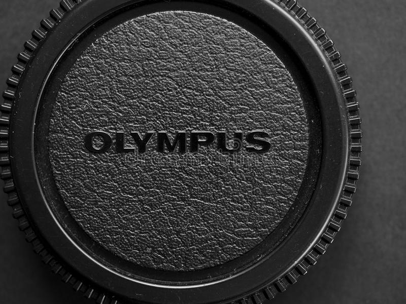 Olympus lens cap in Tokyo. TOKYO, JAPAN - CIRCA JANUARY 2017: Olympus logo on lens cap royalty free stock images