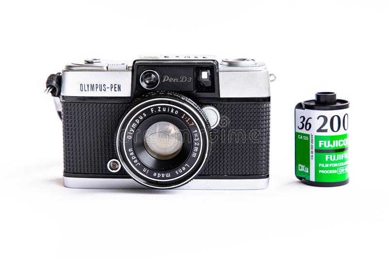 Olympus pen d3 vintage film camera with 35mm film cartridge isolated on white background. BANGKOK, THAILAND - June 29, 2019 : Olympus pen d3 vintage film camera stock image