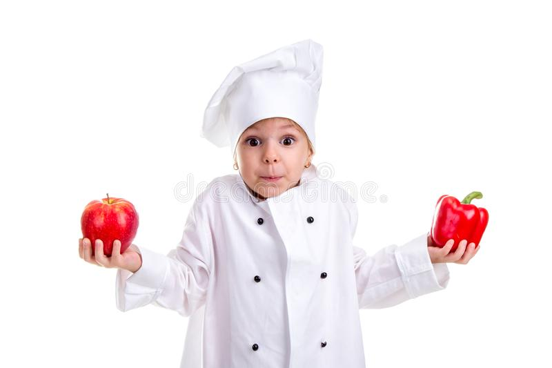 Om een besluit hard te nemen Chef-kokmeisje in een GLB-kok eenvormig met beide omhoog wapens die, rode groene paprika in één hand royalty-vrije stock afbeeldingen