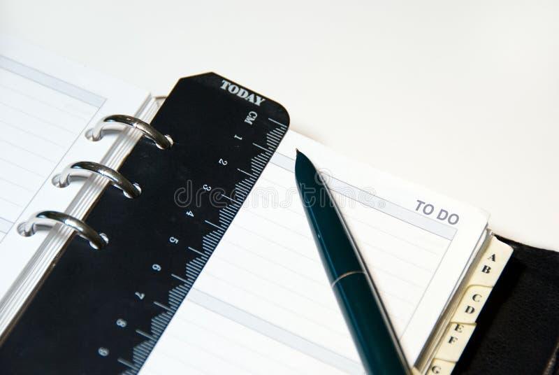 Om organisator met Pen te doen royalty-vrije stock afbeelding