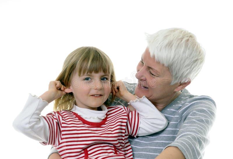 Oma en kleindochter stock foto's