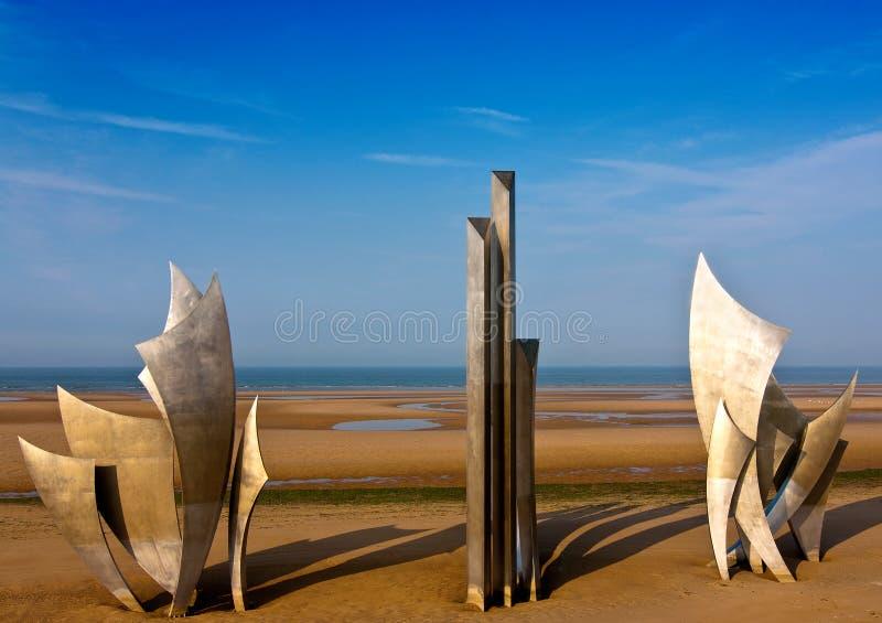 Omaha Beach. Les Braves sculpture on Omaha Beach in Normandy royalty free stock photos