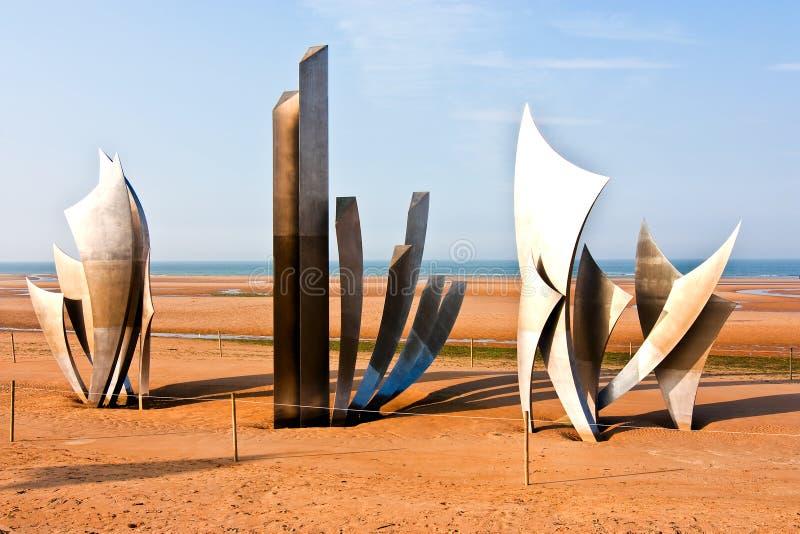 Omaha Beach. Les Braves sculpture on Omaha Beach in Normandy stock photos