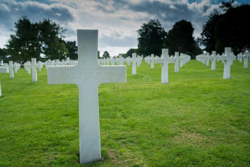 Headstone of an unmarked grave and unknown soldier at the American Cemetery at Omaha Beach. Omaha Beach, Normandy / France - 16 August 2019:  headstone of an stock photos