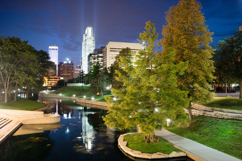 Omaha Nebraska downtown city park skyline dusk night. City features park night waterfront downtown city skyline Omaha Nebraska river walk royalty free stock photography