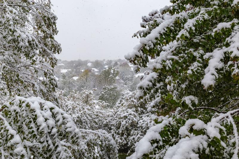 Neighborhood under siege: First snow of 2018 winter season in Omaha Nebraska USA. An Omaha neighborhood, photo taken through an upper level window, under siege royalty free stock images