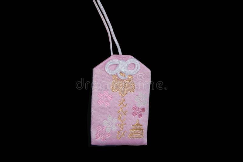 Omamori - japansk berlock royaltyfria bilder