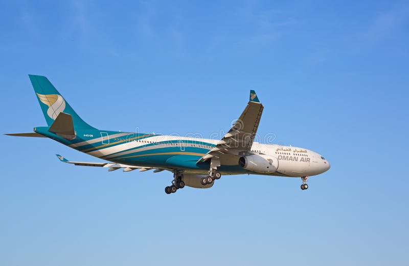 A-330 Oman Air. ZURICH - JULY 18: A-330 Oman Air landing in Zurich airport after long haul flight on July 18, 2015 in Zurich, Switzerland. Zurich airport is home stock photo
