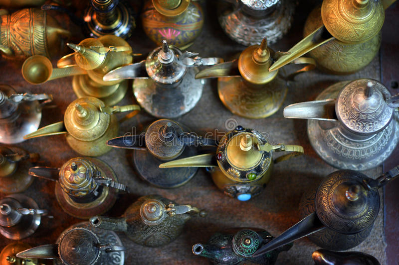 Oman: Arabic coffee pots in Mutrah souk stock images