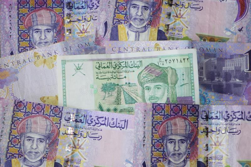 Oman currency. Banknotes of 1 Omani rial and 100 baisa stock photos