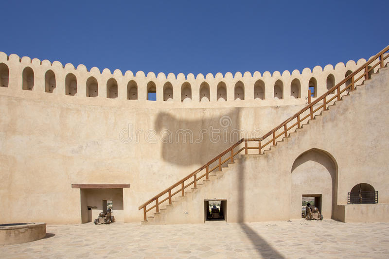 Oman flag Shadow on Nizwa castle royalty free stock photo