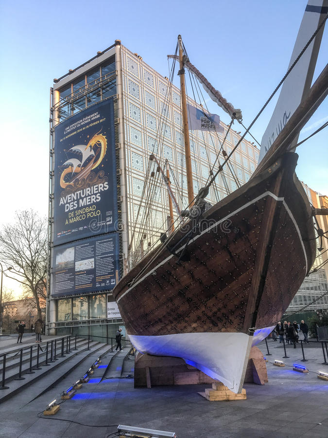 Omani dhow ship in front of l`Institut du Monde Arabe, Paris, France royalty free stock photo