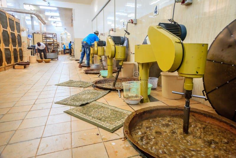 Omani halwa factory. NIZWA, OMAN, MAY 27, 2016: production floor of Nizwa halwa factory stock image