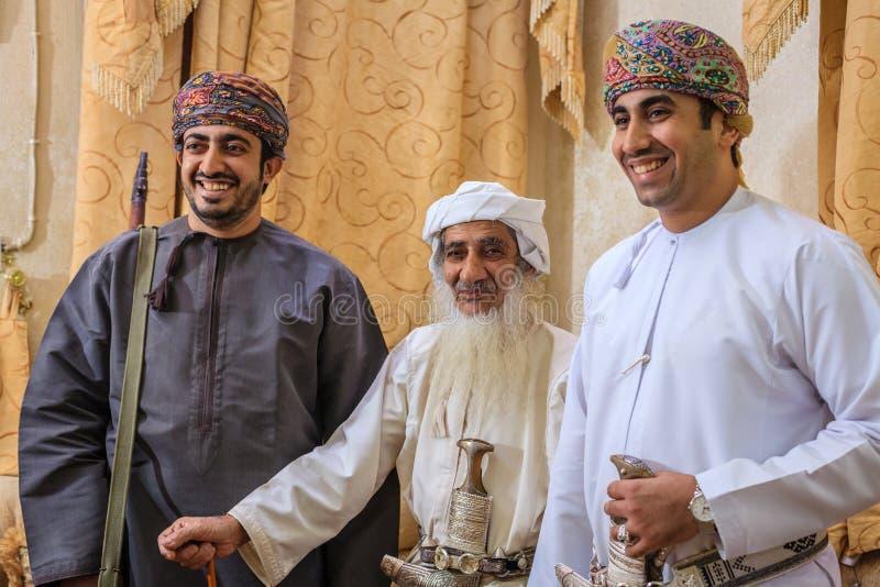 Omani halwamakers stock afbeeldingen