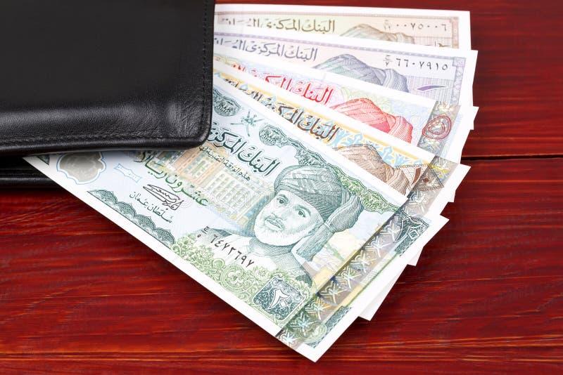 Omani Rial in de zwarte portefeuille royalty-vrije stock fotografie