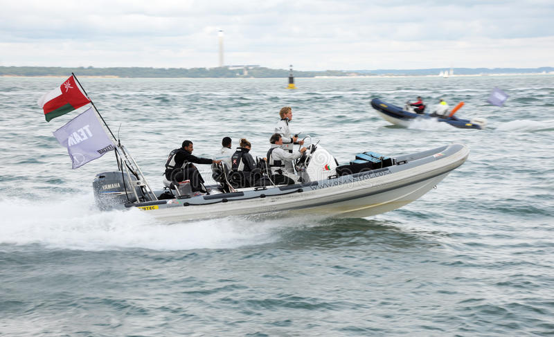 Omani RIB at speed. A rigid inflatable boat (RIB) at high speed during the Cowes regatta. The RIB was a tender for the Oman racing team royalty free stock photography