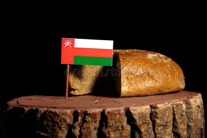 Omani vlag op een stomp met brood royalty-vrije stock foto's