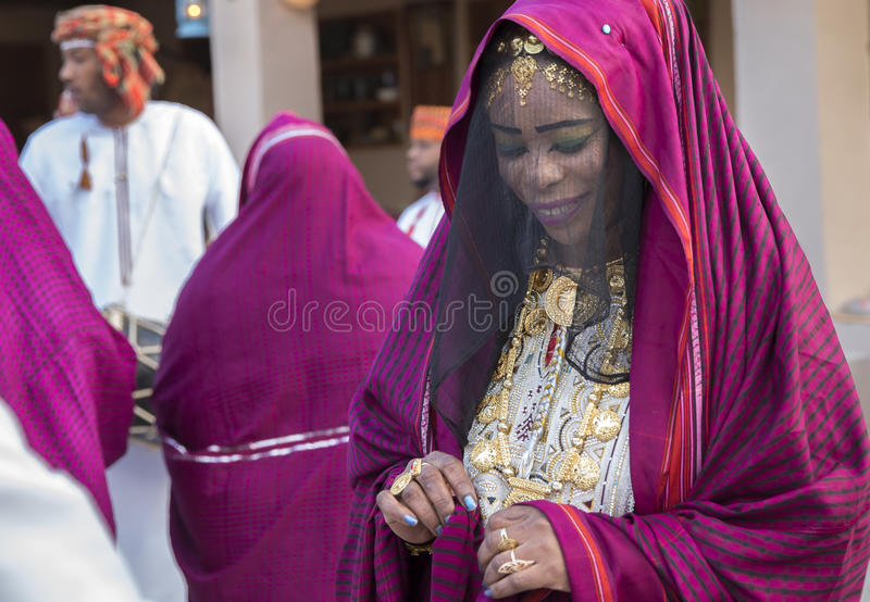 Omani woman in traditional dress, dancing stock photography