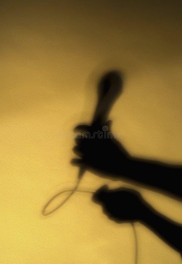 Ombra della mano con il microfono immagine stock