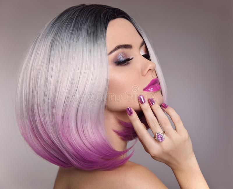 Ombre bob hair woman. Glitter Makeup. Manicure nails. Beauty Portrait of blond model with short shiny hairstyle. Concept Coloring. Hair. Fashion jewelry royalty free stock photos