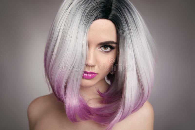 Ombre bob hairstyle blonde girl portrait. Purple makeup. Beautiful hair coloring woman. Fashion Trendy haircut. Blond model with stock photos