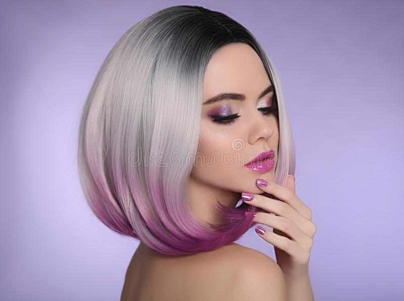 Ombre bob short hairstyle. Beautiful hair coloring woman. Trendy. Haircuts. Purple Manicured nails. Blond model with short shiny hairstyle. Concept Coloring royalty free stock photography