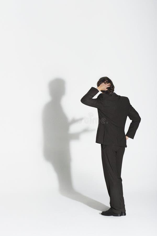 Ombre d'Arguing With Own d'homme d'affaires photo stock