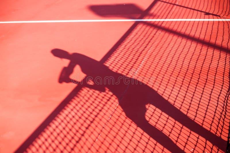 Ombre de concept de concurrence de tennis de femme photos stock