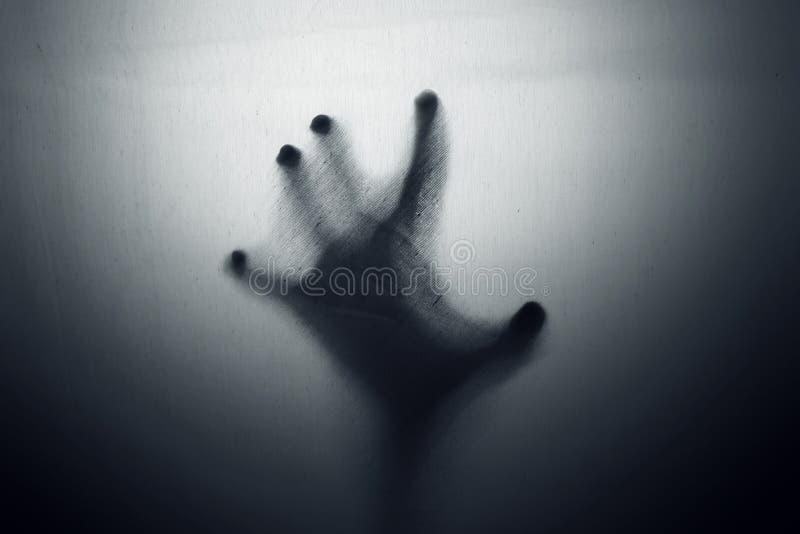 Ombre de main fantomatique effrayante image libre de droits