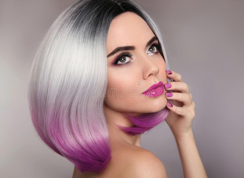 Ombre hairstyle. Beauty makeup and manicure nails. Colored blond stock photos