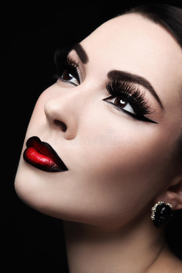 Ombre lips. Close-up portrait of young beautiful woman with gothic ombre lips stock image