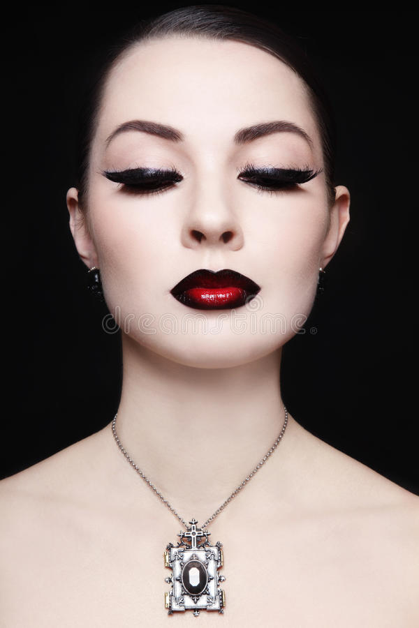 Ombre lips. Portrait of young beautiful woman with gothic ombre lips and necklace stock photo