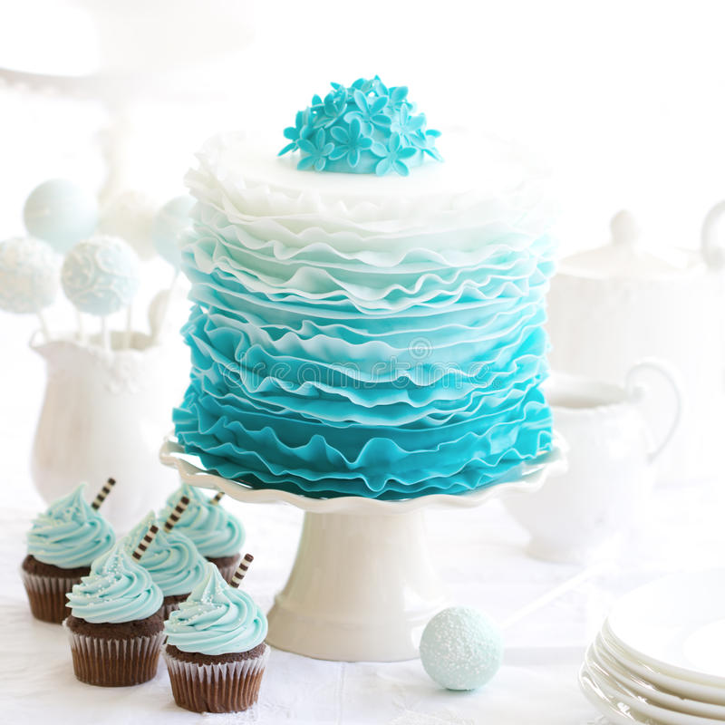Ombre ruffle cake. On a dessert table royalty free stock photo