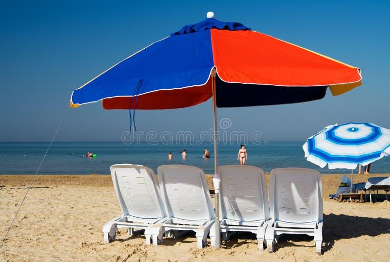 Download Ombrello di spiaggia fotografia stock. Immagine di sunbath - 3149156