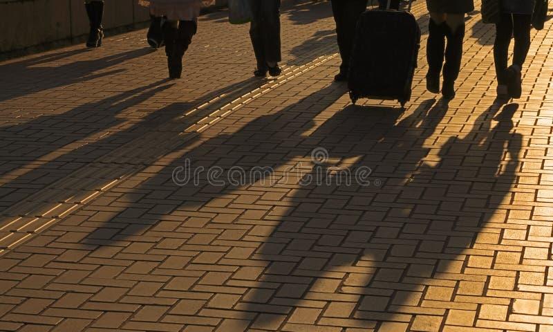 Ombres de voyageurs images stock