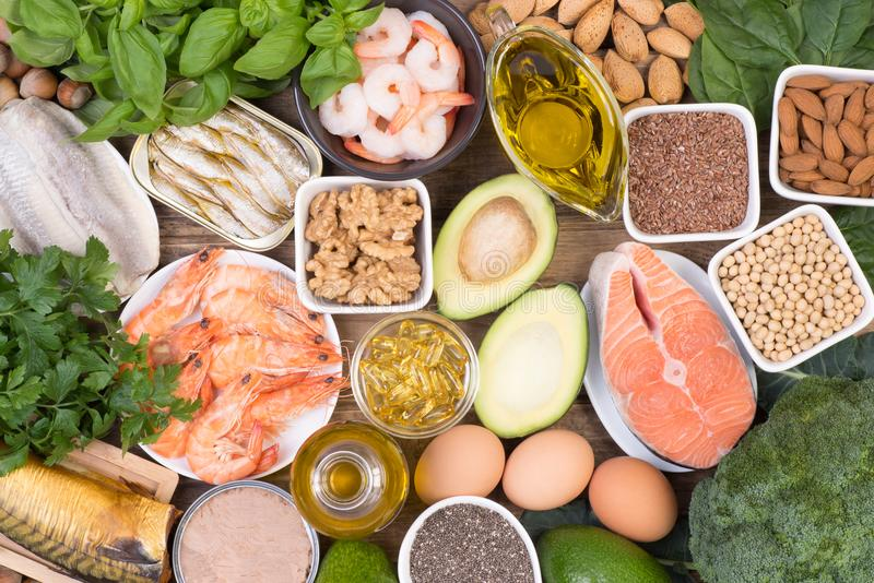 Omega 3 fatty acids food sources. Food sources of Omega 3 fatty acids such as grains, fruit, vegetables and fish, top view royalty free stock images