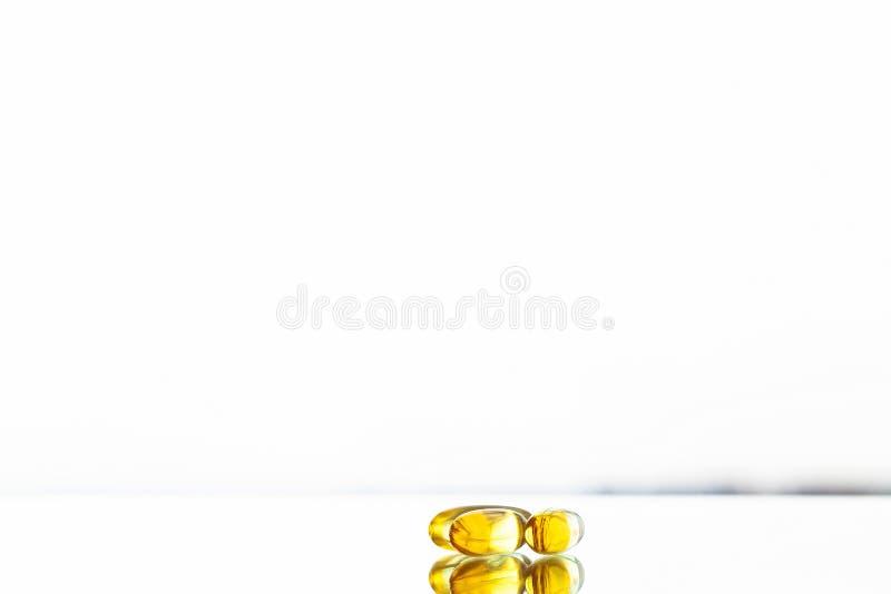 Omega 3 fish oil yellow soft gel capsules stock photos
