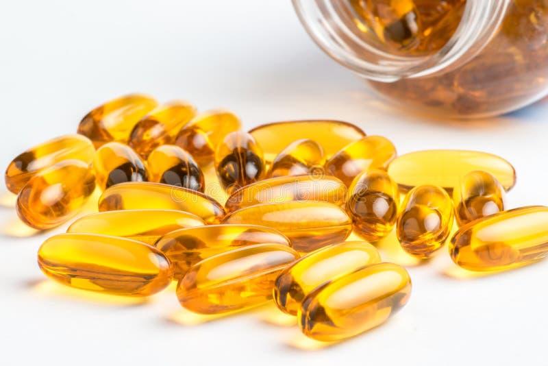 Omega 3 pillole e bottiglie fotografia stock