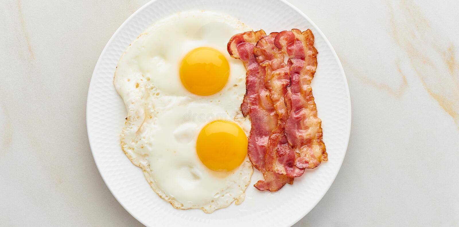 Omelet with bacon top view foodmap ketogenic diet banner. Fried eggs with bacon, foodmap ketogenic keto diet, top view, banner royalty free stock photos