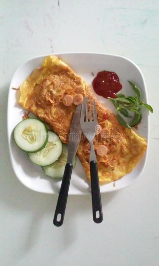 Omelet with cucumber slices stock photo