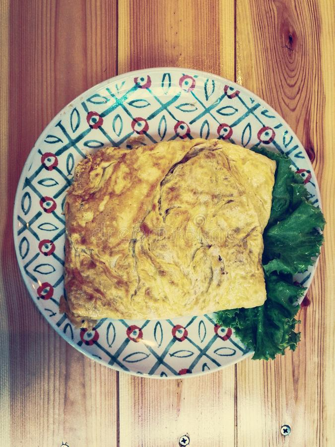 Omelet on dish stock photography