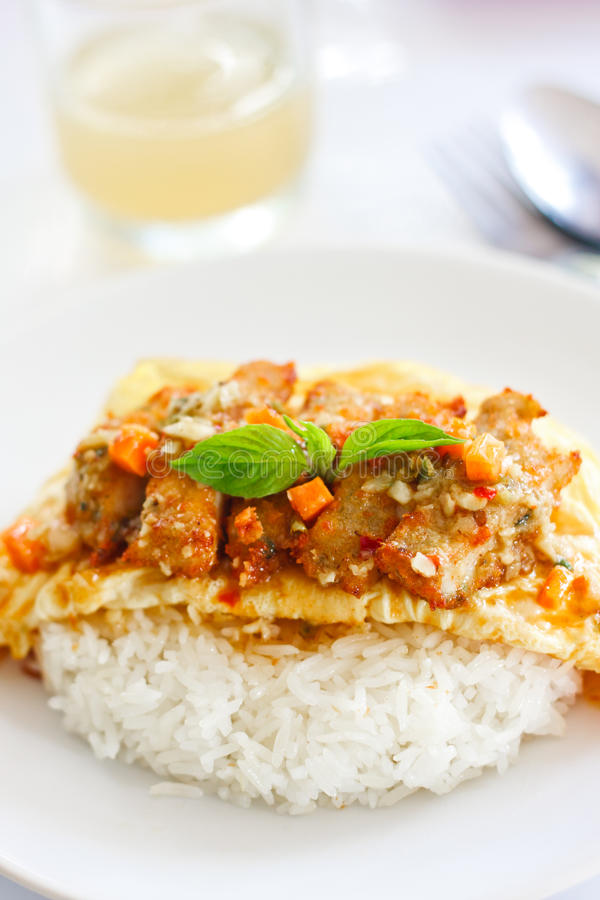 Omelet with Fire Chicken and Cooked Rice royalty free stock photo