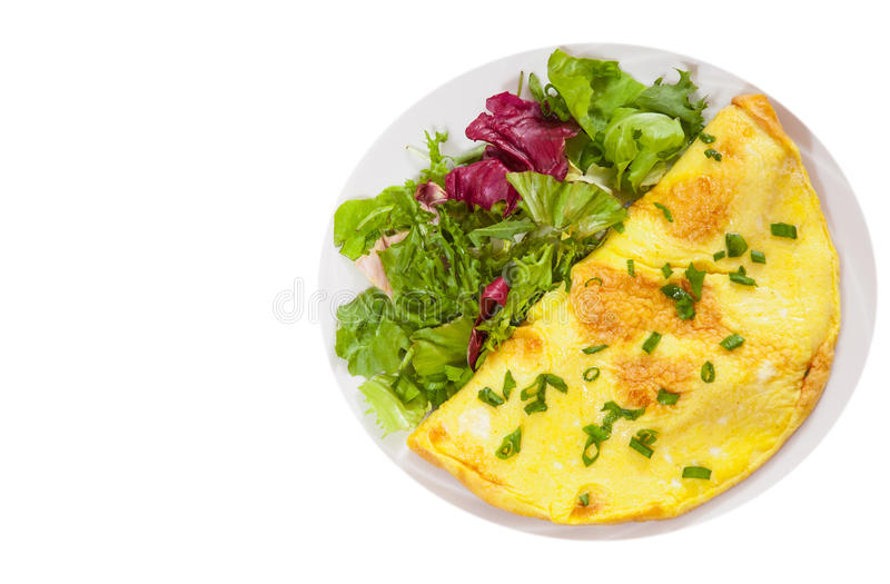 Omelet with fresh mixed salad leaves. top view. isolated stock image