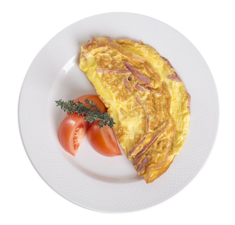 Omelet with ham and tomatoes. stock photography