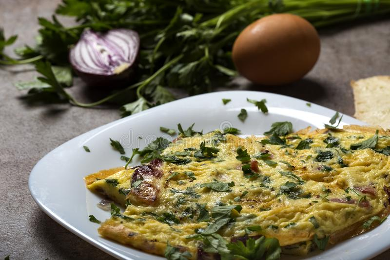 Omelet made from eggs, bacon, cheese and onion stock photo