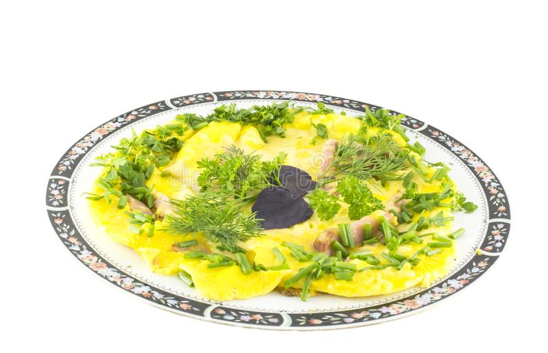 Omelet with melted cheese and healthy garden herbs isolated on white background stock photography