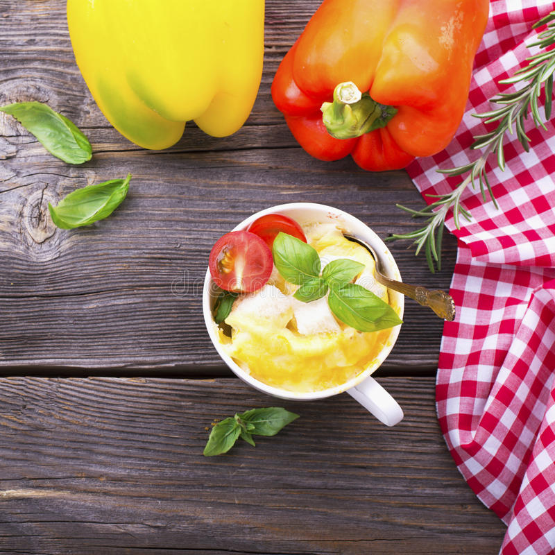 Omelet in a mug prepared in microwave . horizontal permission. selective focus stock photo