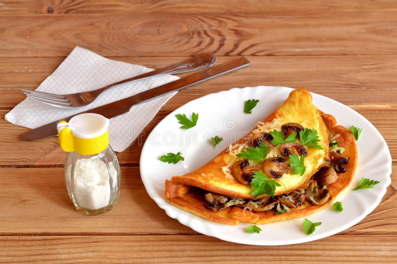 Omelet with mushrooms, cheese and parsley stock images